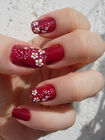 simple red polish with white flowers nail art
