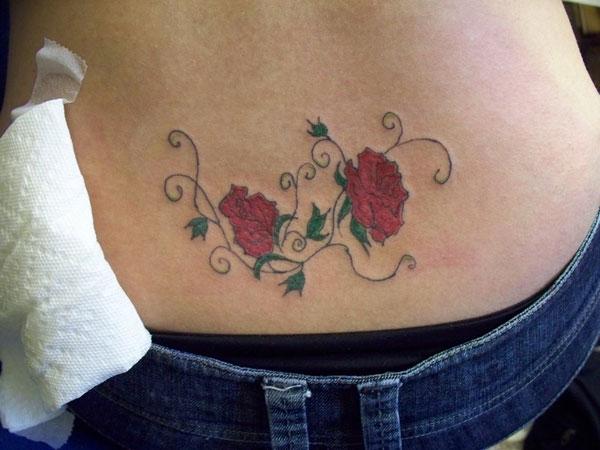 Flowers of wisdom lower back tattoo