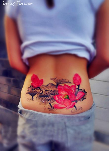 25 cute lower back flower tattoos for girls entertainmentmesh pretty watercolor paint pink black flower tattoo on lower back mightylinksfo