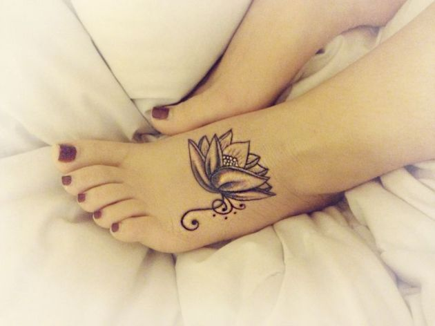 Glamorous and stunning lotus flower tattoo on foot