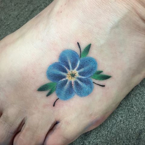 Little simple single forget me not foot tattoo
