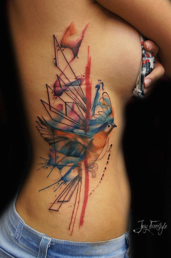 abstract bird tattoo on ribs