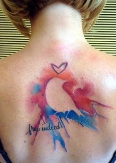 silhouette watercolor painted bird tattoo