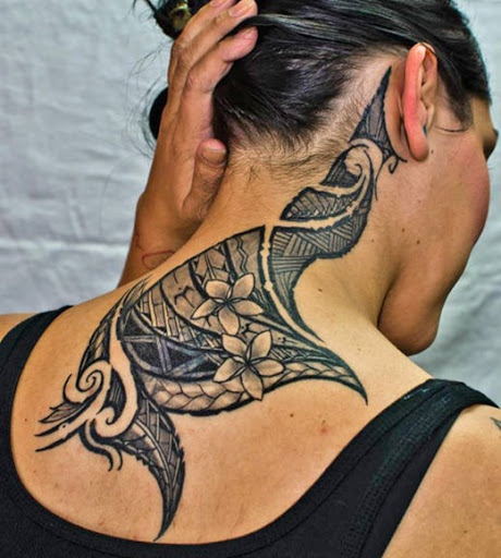 A Maori style neck tattoo design behind neck for girls