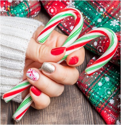 Christmas Holiday nail art of bright red and white polish with gems, glitter, Christmas tree and snowflakes