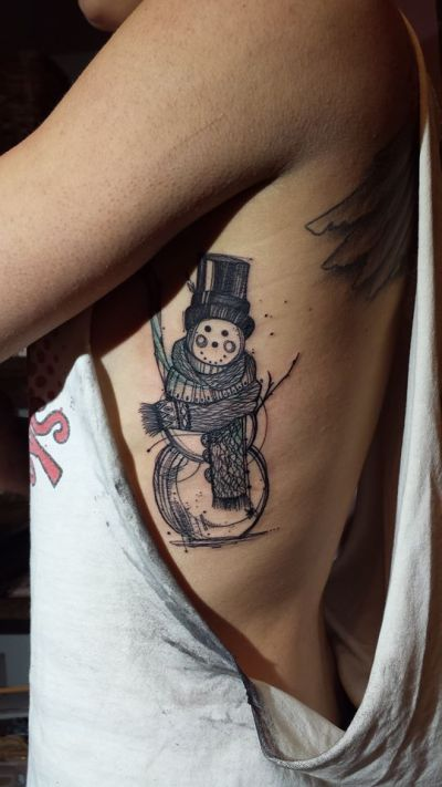 black and white snowman rib cage tattoo