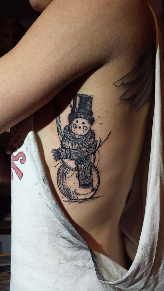 black and white snowman rib cage tattoo