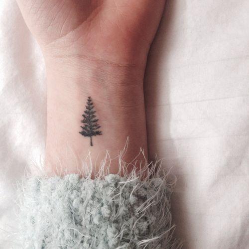 cute pine tree wrist tattoo