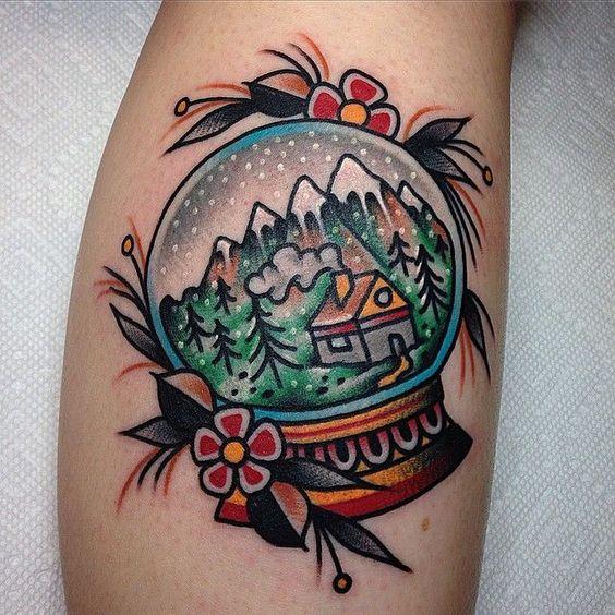winter traditional snow globe tattoo