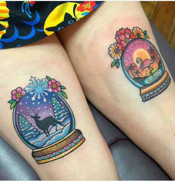 winter traditional snow globe tattoos on both thigh