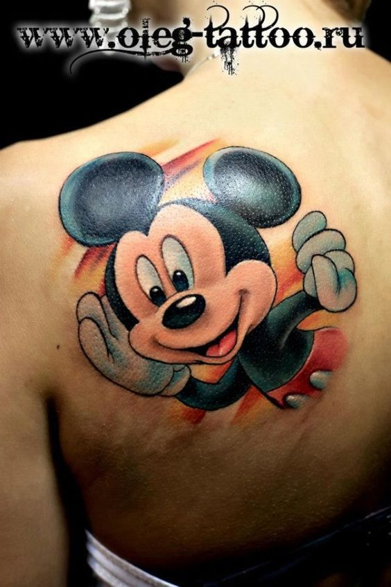 Mickey Mouse Tattoo on upper back shoulder