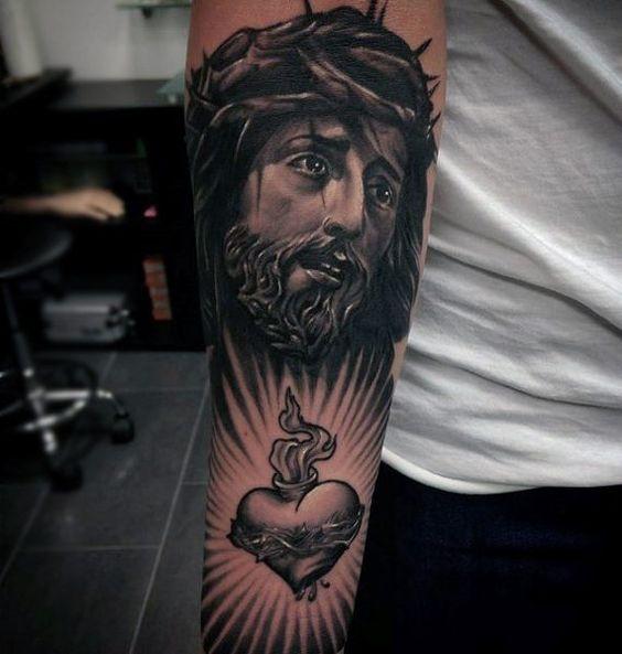 Jesus portrait tattoo on arm