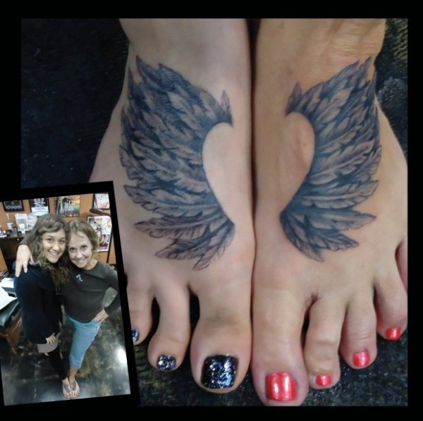 heart with angel wings tattoo