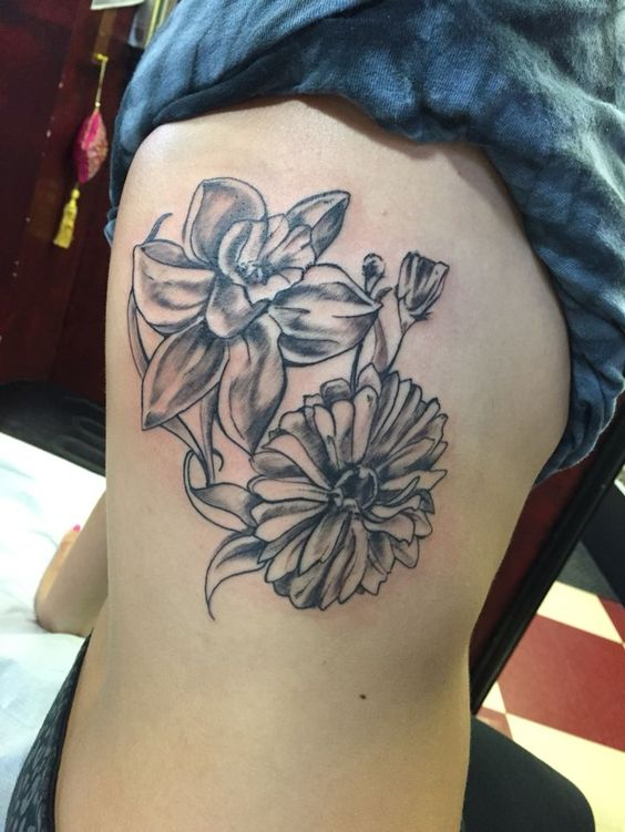 Daffodil and Aster Flower tattoo on side ribs
