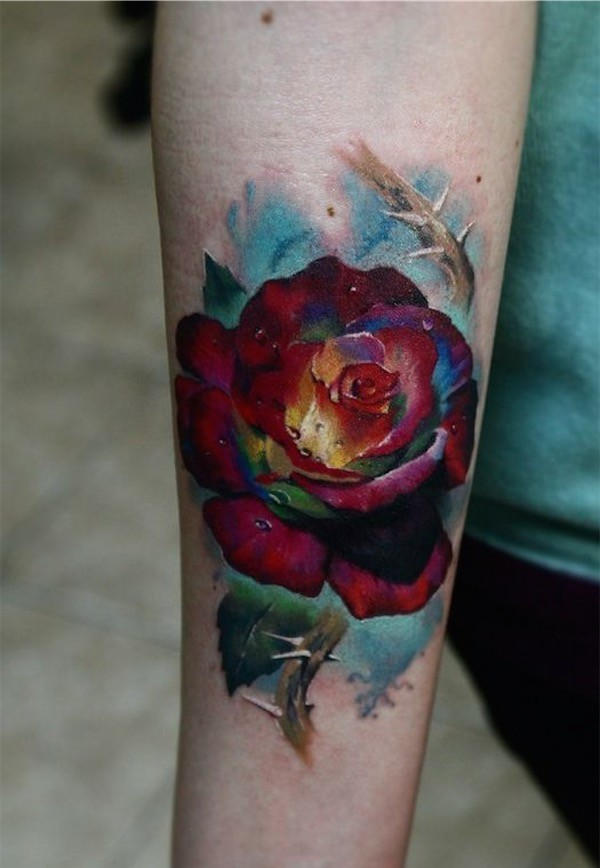 Gorgeous Multicolored Rose Tattoo on forearm