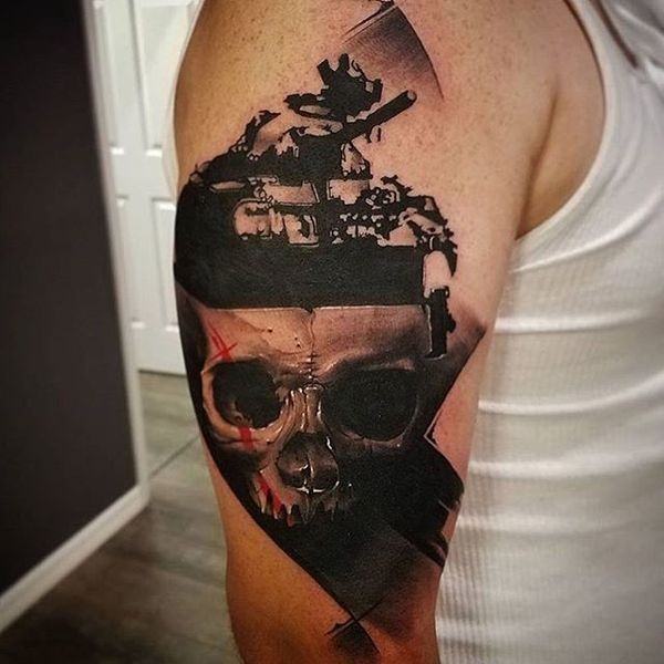 Polka Trash War Tattoo on sleeve