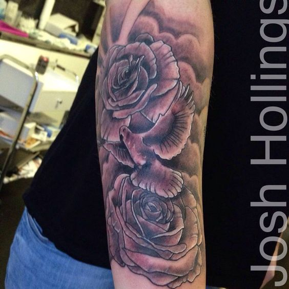 dove and roses tattoo on arm