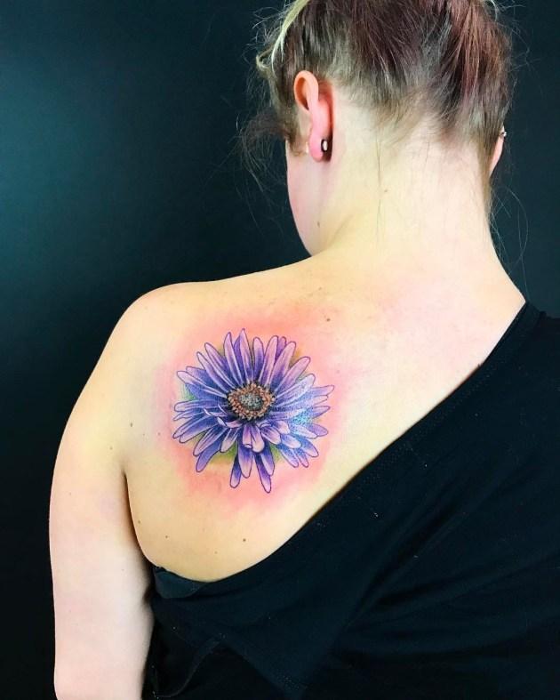September birth flower aster tattoo on back