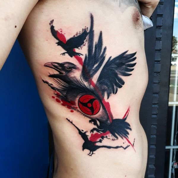trash polka black crows tattoo on ribs