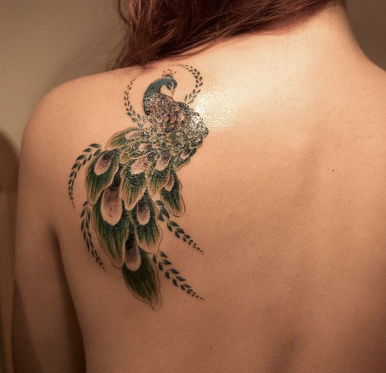 beautiful peacock tattoo on back shoulder blade for women