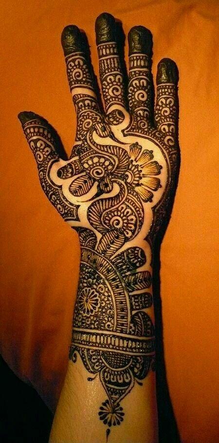 paisley mehndi design on front hand for women