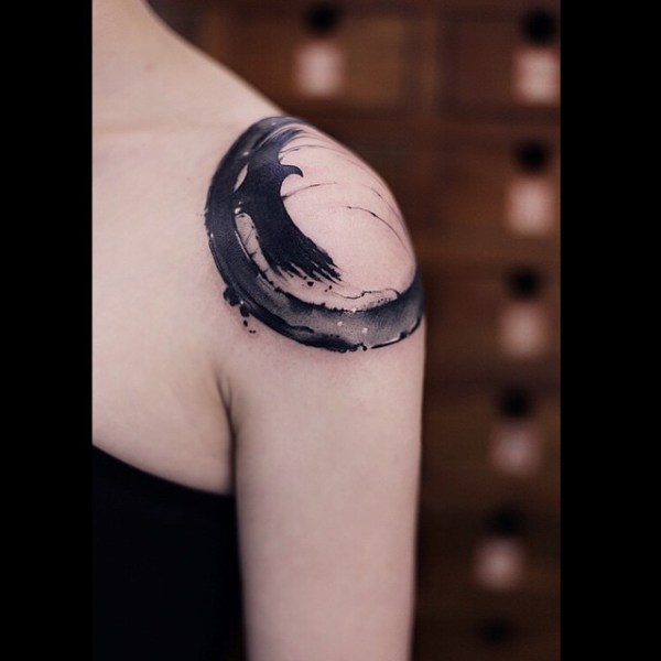 zen circle with raven tattoo on shoulder for women