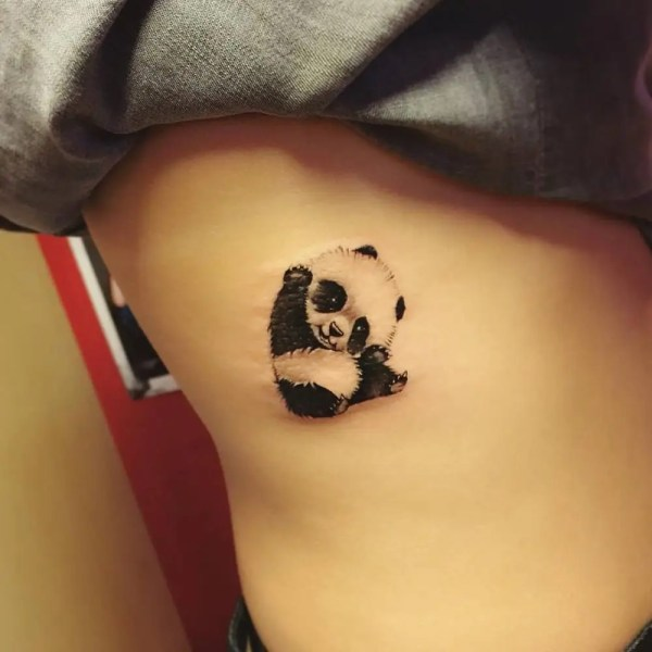 cute simple baby panda drawing tattoo on ribcage