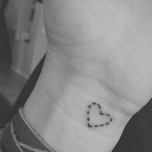 small dashed line heart tattoo on wrist