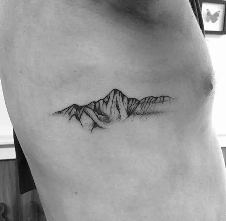 Small Rib Cage Mountains Tattoo Design Entertainmentmesh