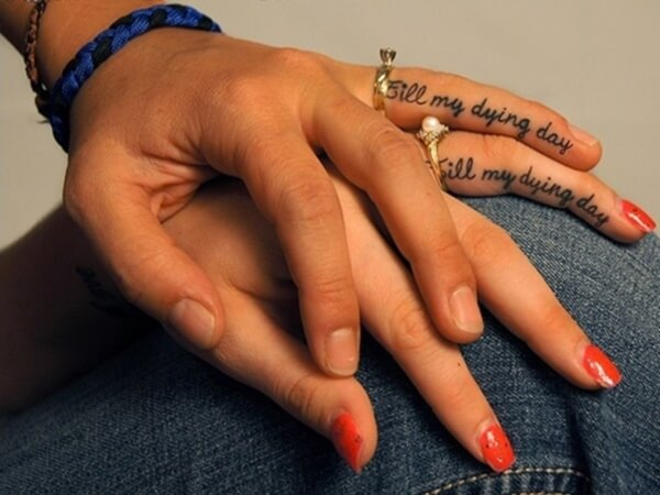 best love quote tattoo on fingers for couples