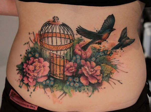 cage lovebirds tattoo on lower back with flowers fields