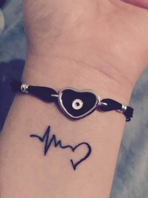 love faith tattoo on wrist