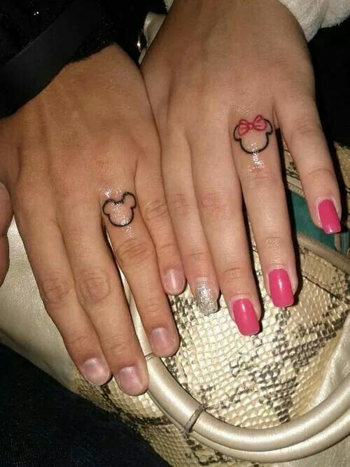 mickey and minnie outline tattoo on fingers for couples