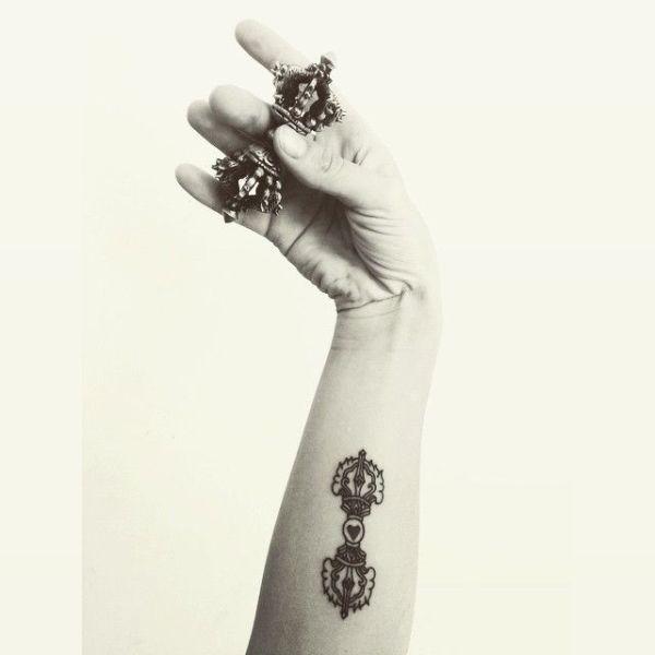 Buddhist vajra symbol tattoo
