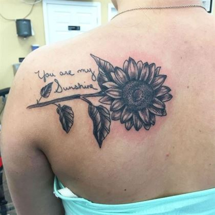 black and grey sunflower with text you are my sunshine tattoo
