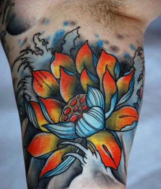 colorful lotus flower tattoo on bicep for men