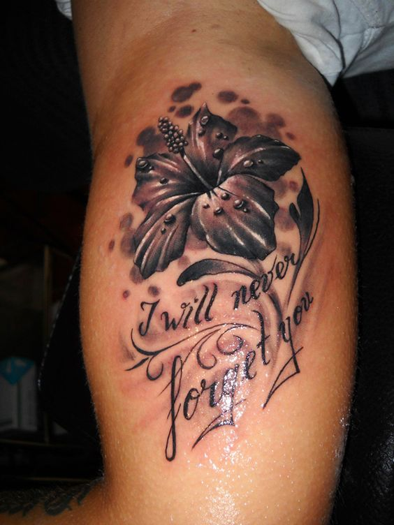 hibiscus flower with quote tattoo on men bicep