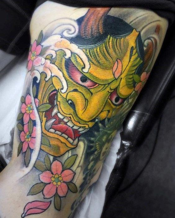 japanese traditional demon mask with cherry blossoms tattoo for men