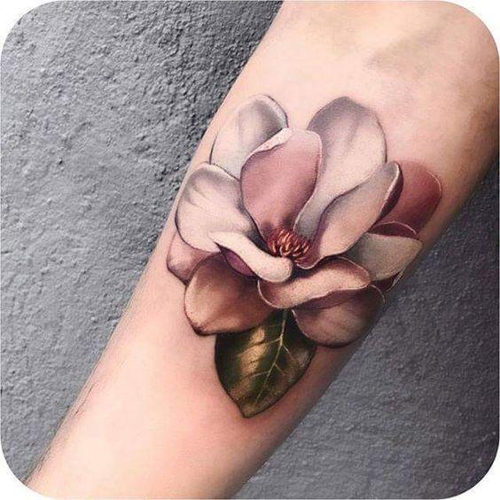 realistic magnolia flower tattoo on men forearm