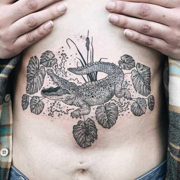 alligator tattoo design with leaves