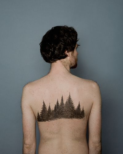 evergreen trees tattoo on back