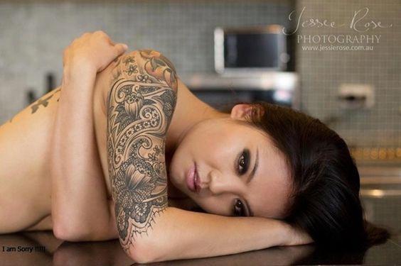female lace flowers tattoo design on half sleeve