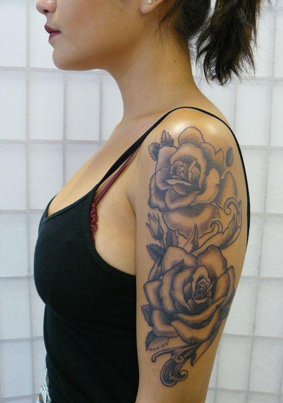 female quarter sleeve black and grey rose tattoo