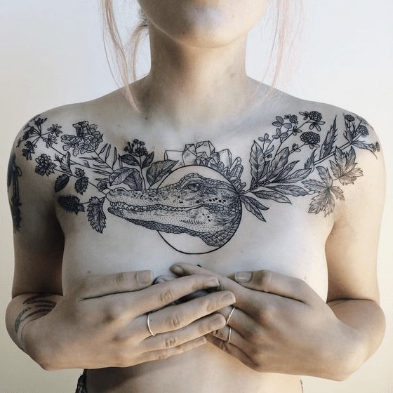 flowers leaves and frame with crocodile tattoo design on upper chest