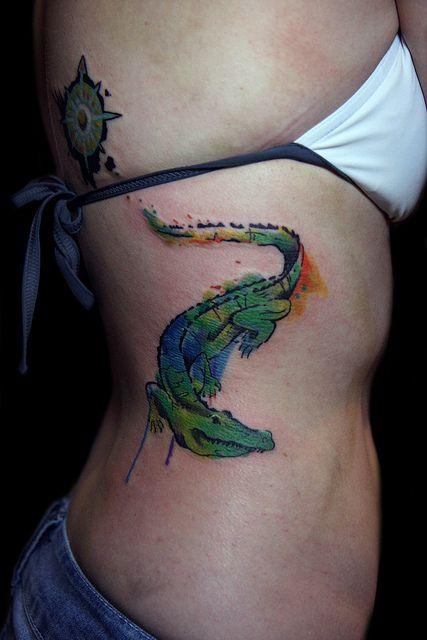 watercolor alligator tattoo design on side ribs