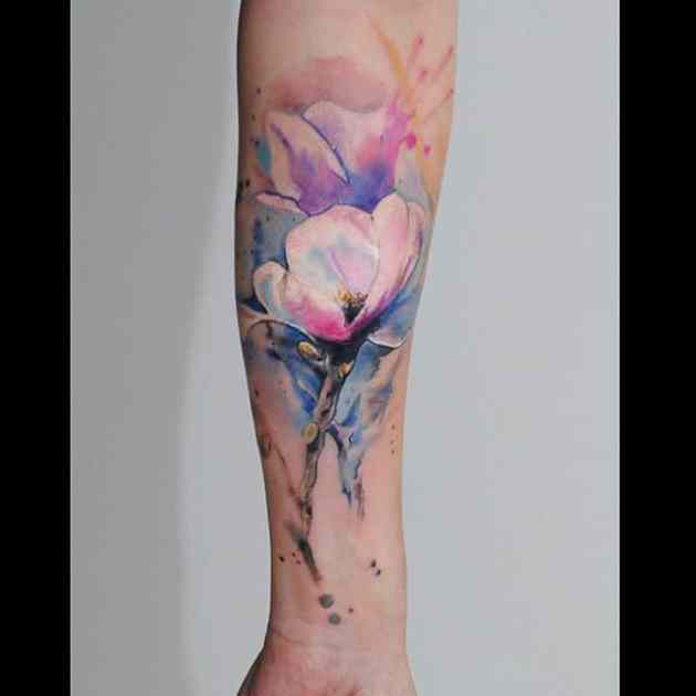 watercolor flower tattoo ideas on forearm