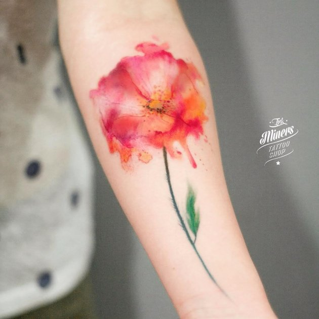 watercolor poppy flower tattoo on forearm