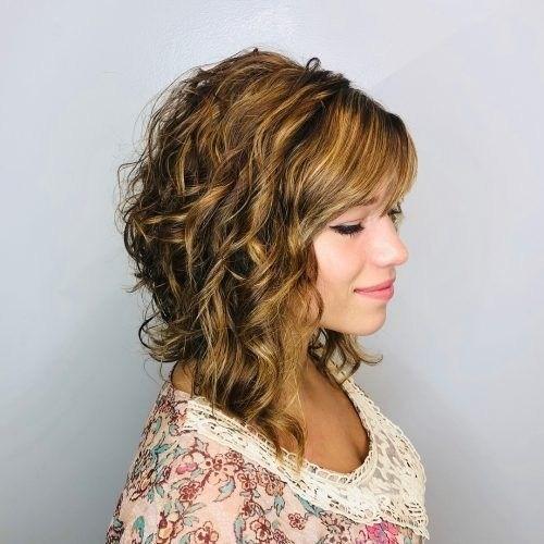 thick curly layered haircut for medium hair