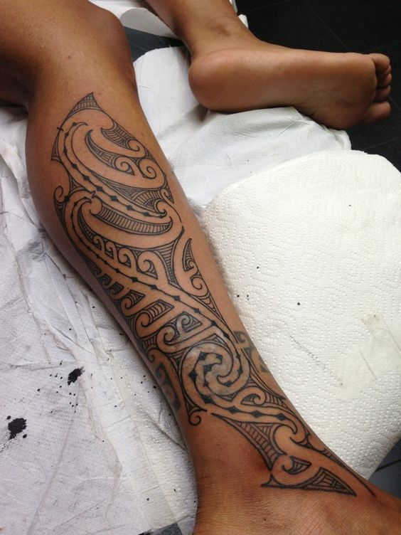 polynesian tribal tattoo on leg for females