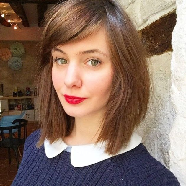 side swept layered bangs haircut for girls with shoulder length hair